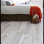 A Scandinavian-style white wood-effect floor that offers fantastic value Series ...